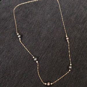14k Gold necklace with black pearls